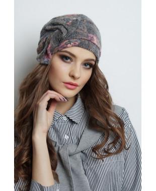 Женская трикотажная шапочка на околыше с перекрученым бантом